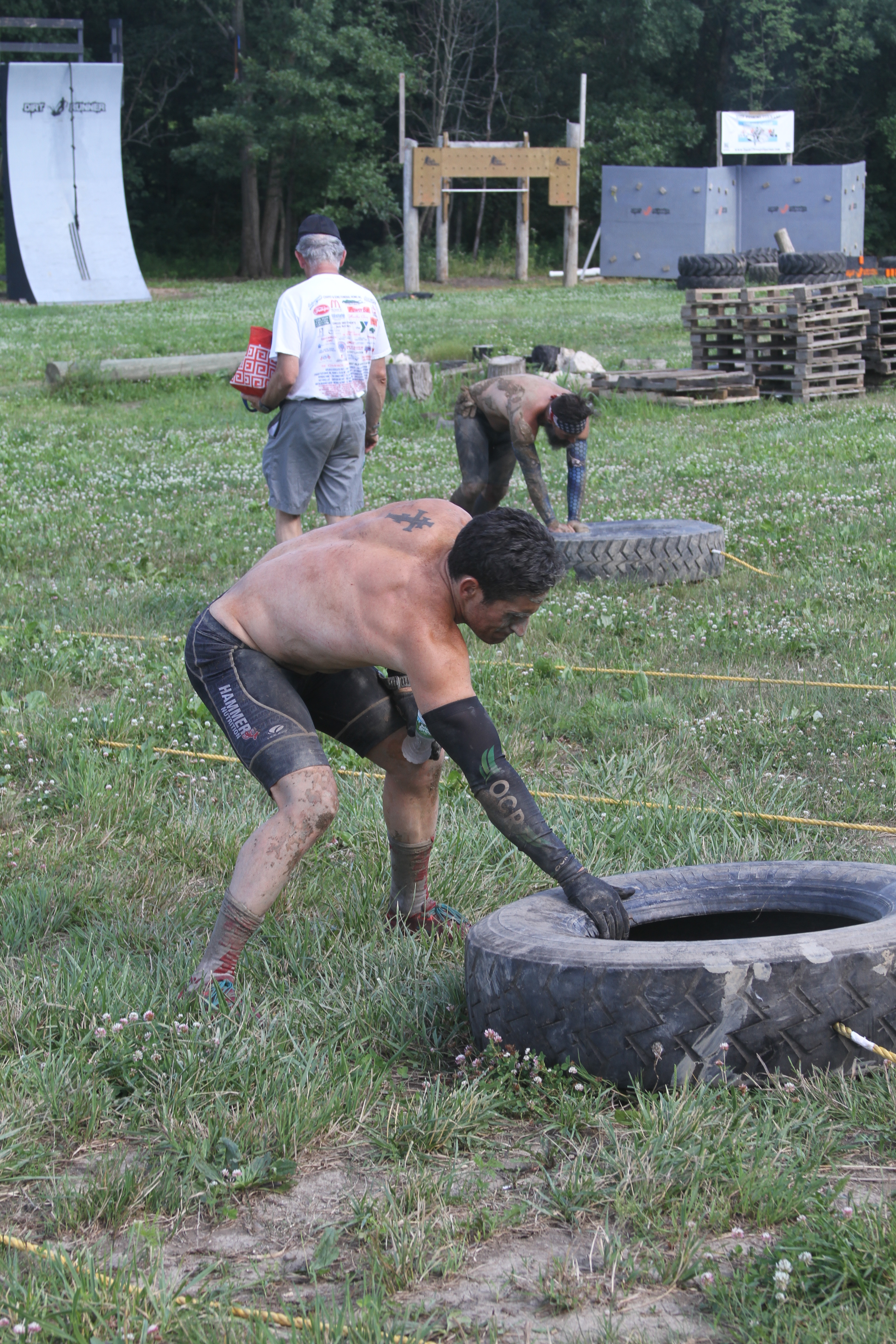 """Evan and Demetrios """"Sty"""" Karellas pulling the tire drag back to its starting position at Dirt Runner."""